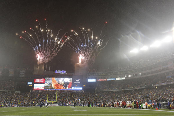 Flares are sent up prior to the Patriots' Sunday night game vs. the 49ers to remember the victims of Sandy Hook Elementary School.