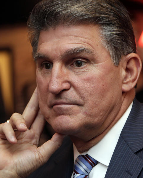 In this Nov. 6 file photo, Sen. Joe Manchin, D-WV.,  watches vote returns at his election watch party in Fairmont, W. Va.  On Monday, Sen. Joe Manchin, a lifelong member of the National Rifle Association, said it was time to discuss gun policy and move toward action on gun regulation.