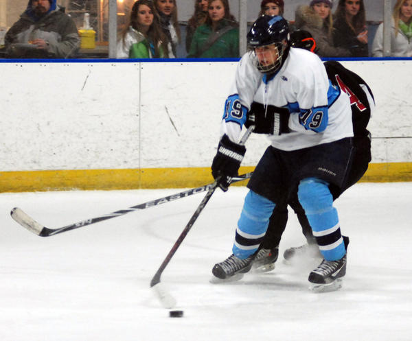 Petoskey senior forward Brandon Pomranke carries the puck out of his own end against the Metro Griffins Friday at Griffin Arena. The Northmen defeated the Griffins, 9-1, on Friday, then fell to Walled Lake Northern, 6-2, in the title game Saturday of the Petoskey Hockey Invitational.