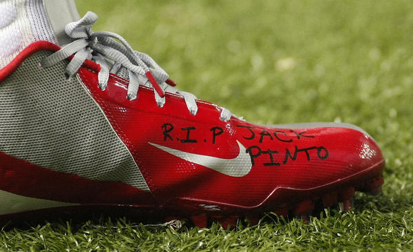 "The shoe of New York Giants wide receiver Victor Cruz bears the words ""R.I.P. Jack Pinto"" in memory of one of the children killed in the Sandy Hook Elementary School shootings in Newtown, Connecticut"