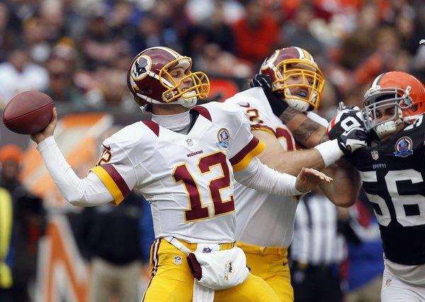 Washington quarterback Kirk Cousins threw for 329 yards, two touchdowns and an interception against the Cleveland Browns on Sunday.