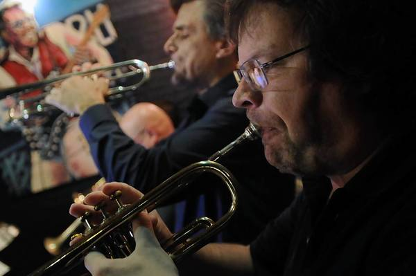 Trumpet players Gabor Viragh, foreground, and Rex Denton.