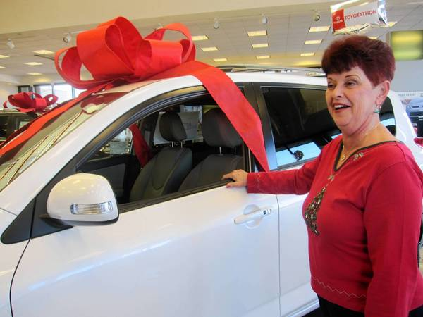 Kathy Kamba takes in the new 2012 Rav4 she plans to purchase with her lottery winnings.