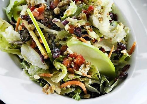 Chopped Salad tossed with red peppers, dried cranberries, walnuts, apples and blue cheese at The Front Street Bistro.