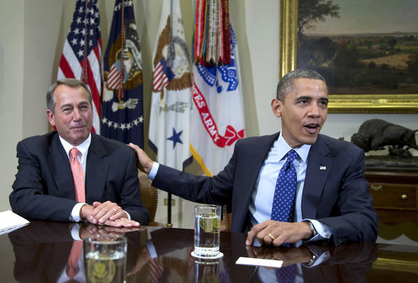 In this Nov. 16 file photo, President Obama acknowledges House Speaker John Boehner of Ohio while speaking to reporters in the Roosevelt Room of the White House.