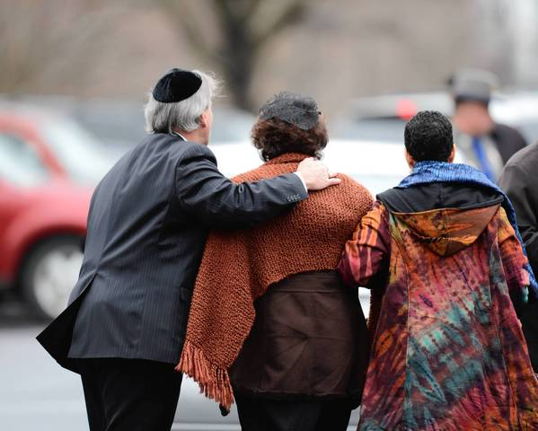 Veronika Pozner, center, mother of Noah Pozner, arrives for her son's funeral at the Abraham L. Green and Son Funeral Home in Fairfield, Connecticut. Funerals began Monday after the school massacre that took the lives of 20 small children and six staff, triggering new momentum for a change to America's gun culture.