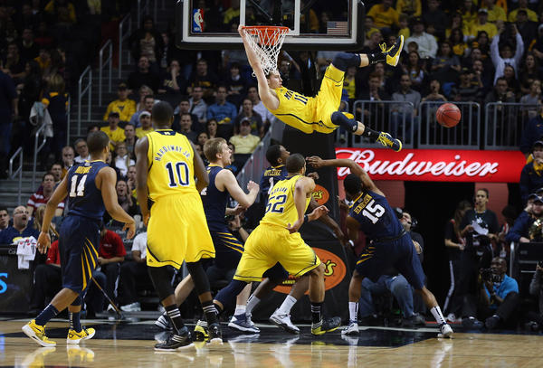 Nik Stauskas #11 of the Michigan Wolverines misses a dunk against the West Virginia Mountaineers during the Brooklyn Hoops Winter Festival on December 15, 2012 at Barclays Center in the Brooklyn borough of New York City. Michigan Wolverines defeated West Virginia Mountaineers 81-66.