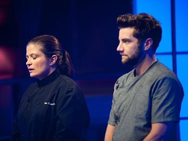 Chef Alex Guarnaschelli reacts with relief after learning that she will move on to the next round of the competition, while Marcel Vigneron learns he is going home.