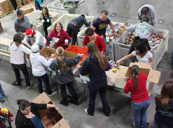 Community members work one of the assembly lines to fill the meal boxes, which were enough to feed a family of eight to 10 people.