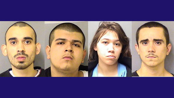Five charged in February slaying.