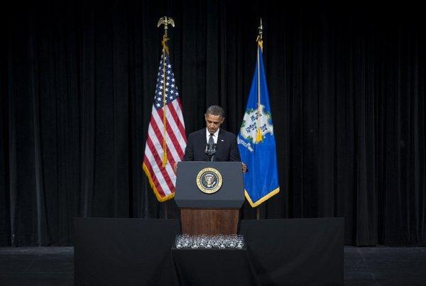President Obama pauses as he delivers a speech at an interfaith vigil in Newtown, Conn., on Sunday.