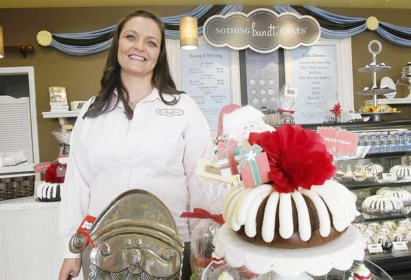 Heather Maestas, the co-owner of Nothing Bundt Cakes, at her new store in Huntington Beach on Friday.