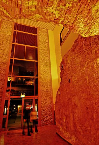 "Technically, only one room of Desert Cave's 19 underground hotel suites was converted; the rest were burrowed in the 1980s. Underground Room 3 once was home to an opal miner. Managing Director Robert Coro says the hotel ""retained the original marks on the sandstone wall. In the old days a miner lived, cooked, slept and stored his gear in one room."""