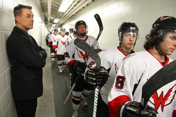 Pete Sauer watches the Wings take the ice last season.