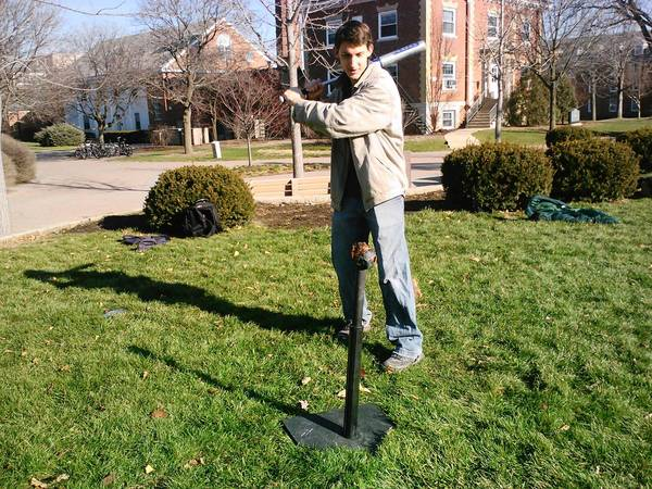 "Daniel Miller, a Wheaton College student, partakes in a game of ""golfimbul"" initiated by the campus' Tolkien Society last week."