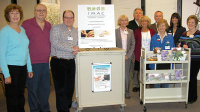 Shown by the Art Cart at Conemaugh Memorial Medical Center are, front row: Catherine Jarvis Rohde, Carl Mahan, John Hargreaves; Dr. Sharon Plank, MaryAnn Ritko, Bonnie Bakos, and Jan Goodard; back row: Barry Ritko, Andrew Rutledge, and Sue Mann, president of Conemaugh Health Foundation.