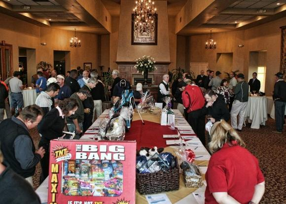 Participants can purchase items during the silent auction as they did at last year's Mesa Verde Classic Charity Golf Tournament.