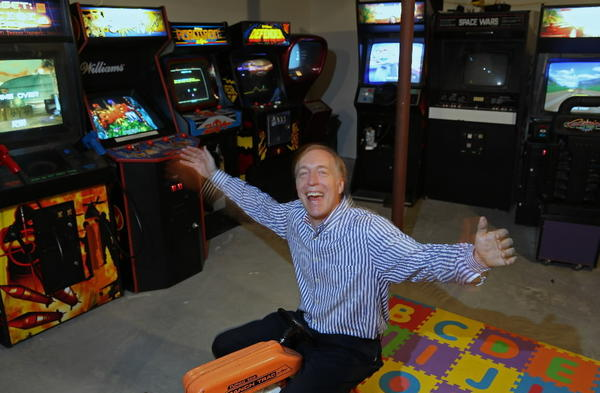 Video arcade game developer Eugene Jarvis in front of some of first creations at his home in Glenview.