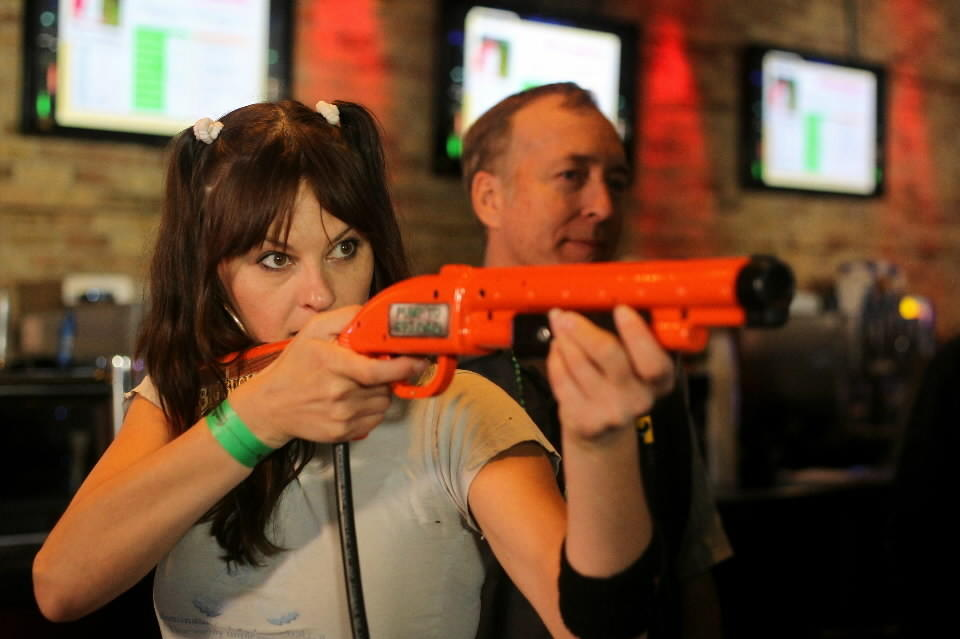 Nina Macdonald plays one of the Big Buck World video arcade games during the Big Buck World Championship as Eugene Jarvis, right, looks on at the Cubby Bear in Chicago last year.