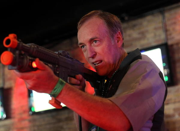 Eugene Jarvis plays the Terminator Salvation video arcade game during the Big Buck Hunter World Championship in Chicago last year. Jarvis recently acquired the company that developed Big Buck Hunter.
