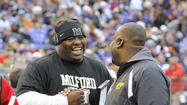 Milford Mill football coach Reggie White, who led the Millers to their first winning season in four years and their first appearance in the state semifinals in seven years, was named the Ravens' High School Coach of the Year Sunday during halftime of the Ravens-Broncos game at M&T Bank Stadium.