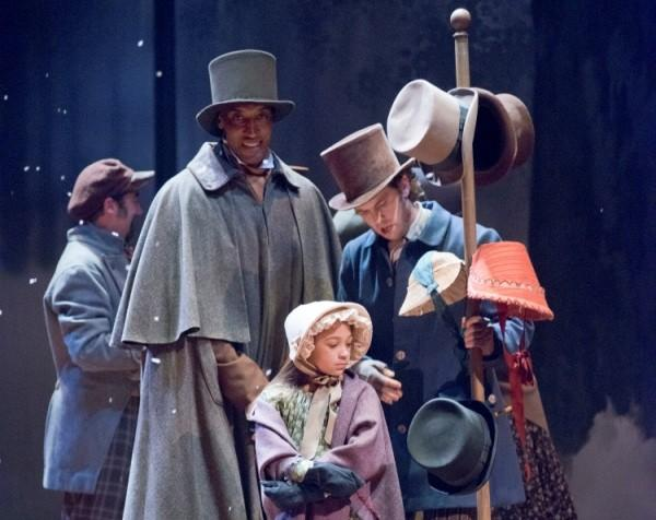 "NBA Hall of Famer Scottie Pippen appears in the Goodman Theatre's production of ""A Christmas Carol"" December 14, 2012 with 7-year-old La'Ren Kimble from Make-A-Wish Illinois."
