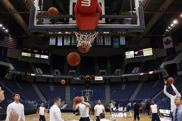 The Connecticut Huskies warm up before the start of the game against the Maryland-Eastern Shore Hawks at the XL Center.