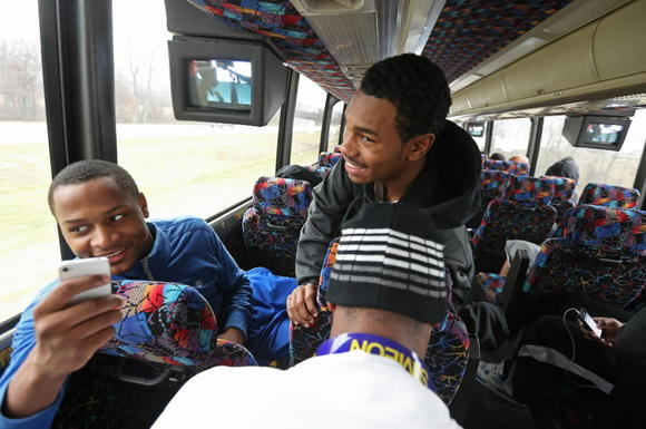 Simeon players share a laugh on the bus ride home from Memphis on Sunday.