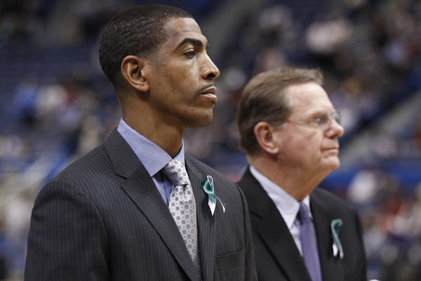 Connecticut Huskies head coach Kevin Ollie and his team wear ribbons to pay tribute to those who were killed at the Sandy Hook Elementary School in Newtown.