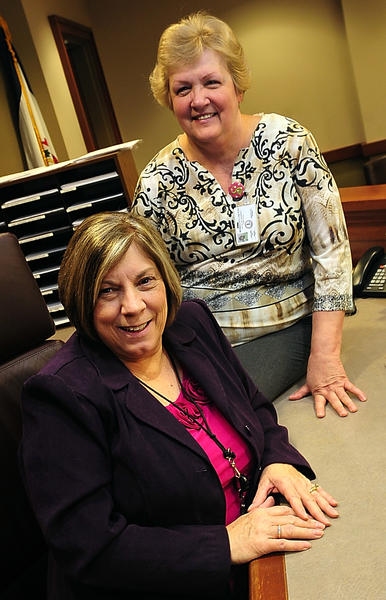 Berkeley County magistrates Joan Bragg, seated, and Sandra Miller recently were sworn in as senior status magistrates. Combined, they have more than 40 years on the bench.