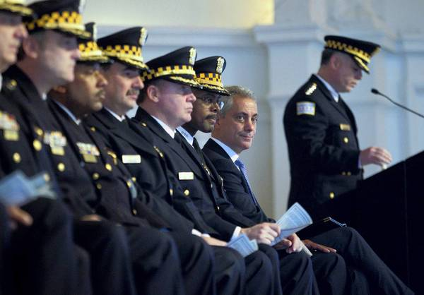 "Mayor Rahm Emanuel, second from right, said at Monday's Chicago Police Department graduation and promotion ceremony: ""It's time that we as a city have an assault weapons ban, it's time that we as a state have an assault weapons ban, and it's time that we as a country have an assault weapons ban."""