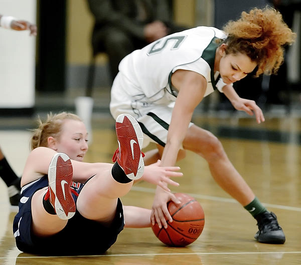 Francis Scott Key'ss Morgan Wolfe loses control as South Hagerstown's Chelsey Scott (5) gets a hand on the ball during Monday night's girls basketball game