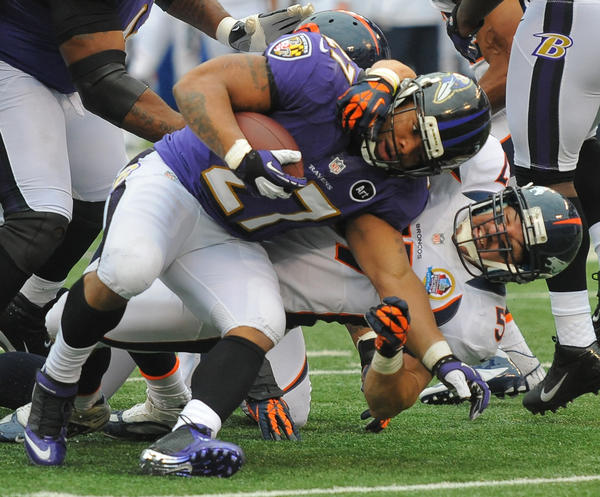 Ravens running back Ray Rice is brought down by Broncos linebacker Keith Brooking on Sunday.