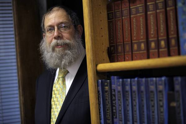 Rabbi Dov Hillel Klein was fired from his position as a campus chaplain with Northwestern University and is now suing the school.