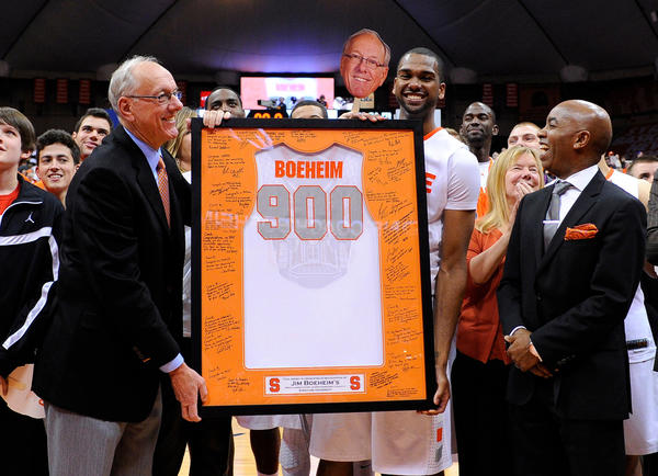 Syracuse coach Jim Boeheim is presented with a commemorative jersey after his 900th career victory.