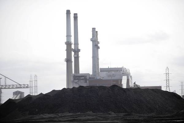 Midwest Generation owns and operates several coal-fired power plants, including this one in Romeoville. The company is facing hundreds of millions of dollars in environmental retrofits at its coal plants.