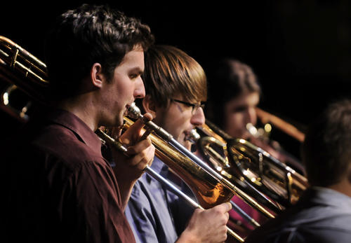 Paul Valleau of Milford, left, and Evan Rzodkiewicz of Poughkeepsie, N.Y., perform with the other members of The Hartt Trombone Ensemble. They performed a selection of Christmas songs in a benefit concert to support the Newtown community Monday night in the Millard Auditorium on the University of Hartford campus.  The benefit raised $1,161.02 for the Sandy Hook School Support Fund.