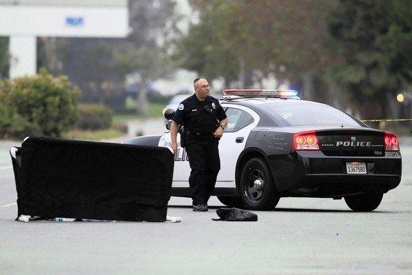 An Irwindale police officer responds at the scene of a hit-and-run in which an 80-year-old woman was killed. A recent federal transportation report found an increase in traffic fatalities among pedestrians and cyclists.