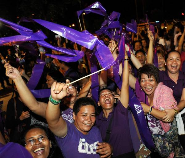 In Quezon City, supporters celebrate passage of the Reproductive Health Bill by both chambers of the Philippine Congress.