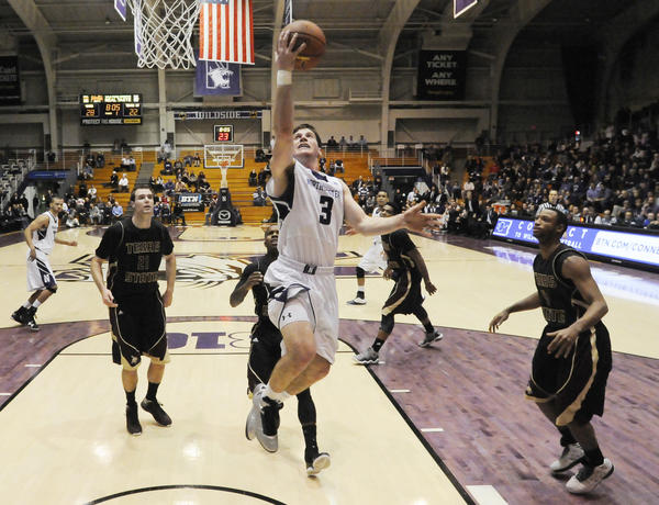 Dave Sobolewski goes to the basket on his way to leading Northwestern with 18 points.