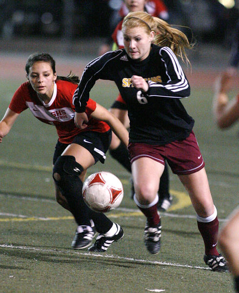 La Canada's Kara Lankey drives toward the goal against Glendale's Ashley Hermosillo in the second half of a non league girls soccer match at Glendale High School on Monday, December 17, 2012.
