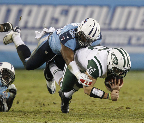 Tennessee Titans' line backer Zach Brown sacks New York Jets' quarterback Tim Tebow.