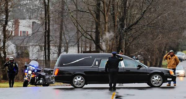A hearse carries the casket of 6-year-old Jack Pinto, one of the children killed at Sandy Hook Elementary School, to the Village Cemetery in Newtown, Conn.