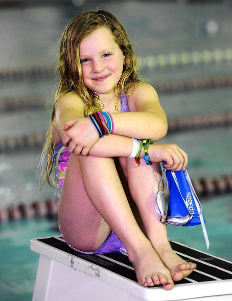 Carly Lenett, 7, of Lower Macungie Township recently swam 100 laps in less than two hours to raise awareness and money for juvenile diabetes.