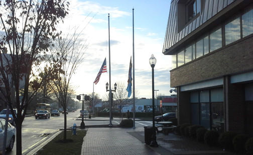 In memory of the Connecticut school shooting victims, flags fly at half-staff outside the Harford County Office Building in Bel Air Tuesday morning.