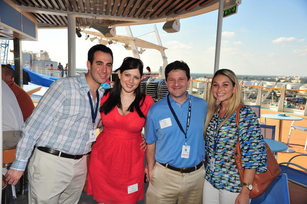 "Cary Levinson, left, Arielle Capuano, Matt Levinson and Jamie Russell at Voices for Children of Broward County's ""An Alluring Afternoon"" event, which took place Nov. 4 aboard the Royal Caribbean International's Allure of the Seas Ship and raised nearly $30,000."