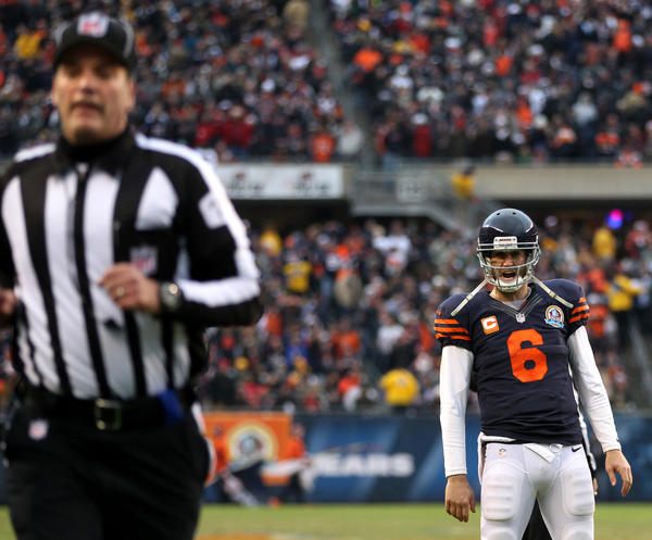 Bears quarterback Jay Cutler argues with an official during the second half against the Packers at Soldier Field on Sunday.