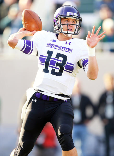 Northwestern Wildcats quarterback Trevor Siemian (13) looks to throw the ball during the 2nd half of the game at Spartan Stadium against the Michigan State Spartans. Northwestern won 23-20.
