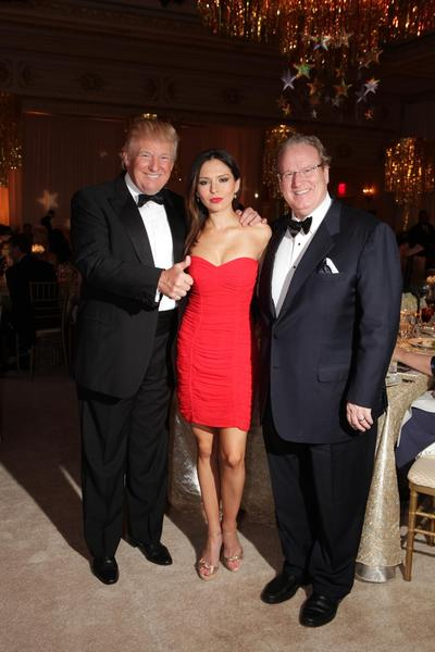 "Donald Trump, left, Lola Astanova and Patrick Park at LIFE's ""Lady in Red Gala,"" which took place Dec. 1 at The Mar-a-Lago Club."
