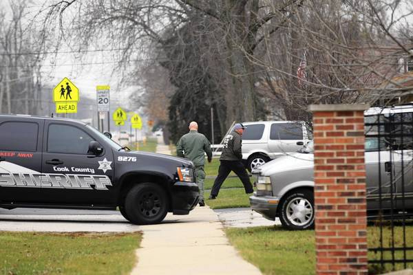 "The Cook County Sheriff's Police K-9 unit search an area in Tinley Park for escaped bank robbers Ken Conley and Joseph ""Jose"" Banks after the two escaped from the Metropolitan Correctional Center in the Loop this morning."